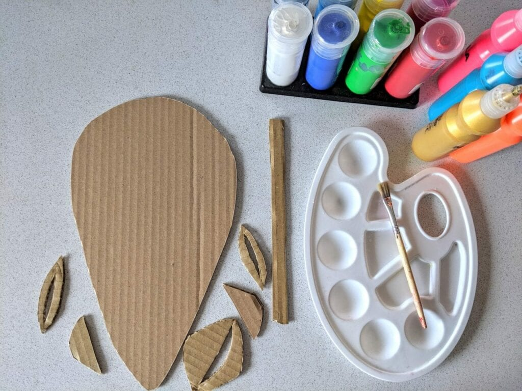Como fazer uma máscara africana de papelão