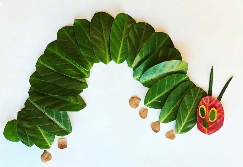 uma lagarta comilona com folhas